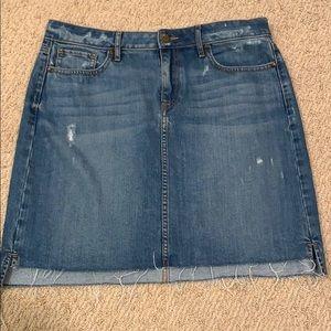Denim skirt with frayed bottom